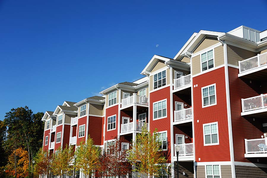 HOA Insurance - View Of Apartment Building Complex Against Blue Sky On Sunny Day